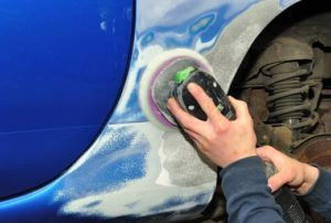 Sanding autobody repairs on a pickup truck